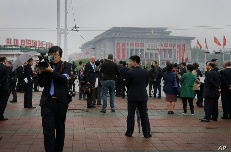 Foreign journalists film and report from across the April 25 House of Culture, the venue for the 7th Congress of the Workers' Party of Korea, May 6, 2016, in Pyongyang, North Korea.