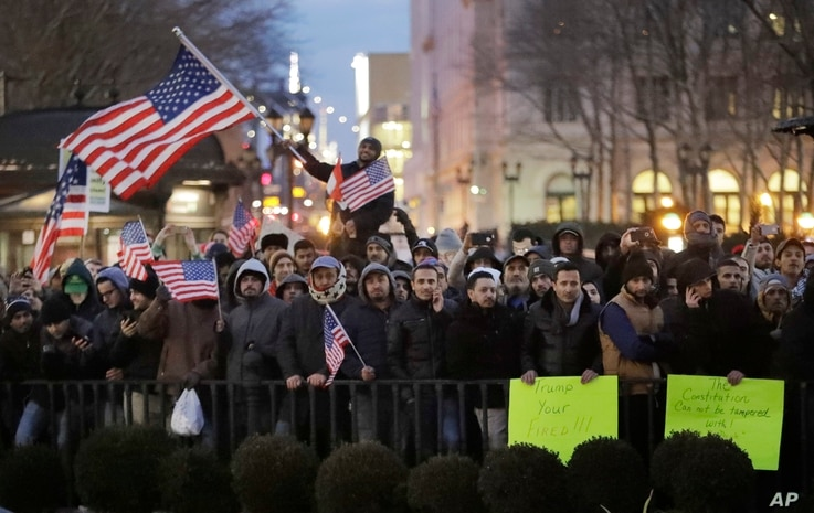 Protesters gather at Brooklyn Borough Hall to protest President Donald Trump's immigration order, Feb. 2, 2017, in New York. More protests are scheduled.