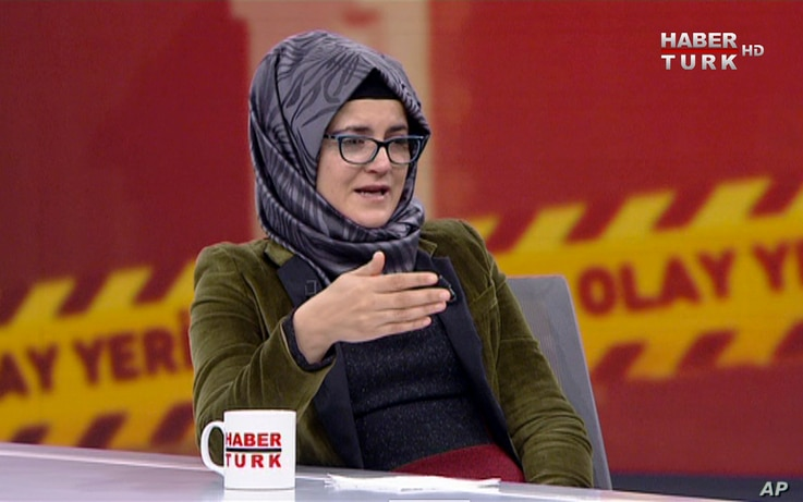 In this image from TV, Hatice Cengiz, who is Turkish, reacts during an interview on Turkish television channel HaberTurk, Oct. 26, 2018, about the day her fiance, Saudi journalist Jamal Khashoggi entered the Saudi Arabia Consulate on Oct. 2, and was ...