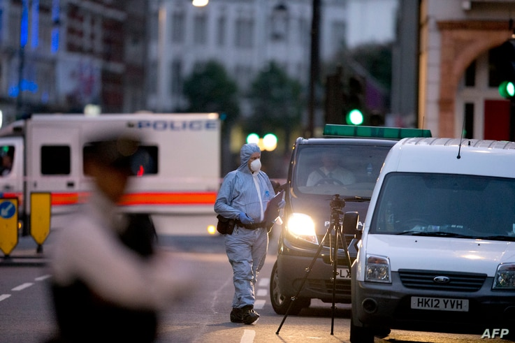 A police forensic officer works in Russell Square in London early on August 4, 2016, after a knife attack in which a woman in her 60s was killed.