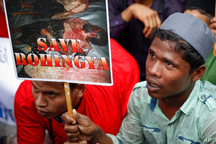 An ethnic Rohingya holds a placard during protest after prayers outside the Myanmar Embassy in Kuala Lumpur, Malaysia, Nov. 25, 2016.