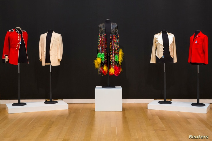 Outfits belonging to musicians Michael Jackson, Elvis Presley, Sly Stone and Jimmy Page are displayed as part of a collection from; 'A Rock and Roll History: Presley to Punk' at Sotheby's auction house in New York, June 20, 2014.