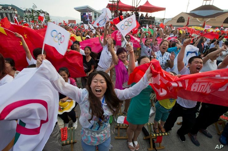 Residents celebrate as Beijing is announced as the host city for the 2022 Winter Olympics at the ski resort region of  Chongli where the Nordic skiing, ski jumping, and other outdoor Olympic events will be held in northern China's Hebei province, Jul...