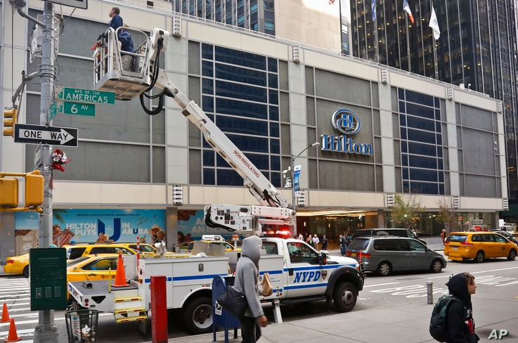 New York City police install security cameras near the Hilton Hotel in New York, Nov. 4, 2016, where Donald Trump organizers will gather on election night. The police and the FBI say they are assessing information they received of a possible al-Qaida...