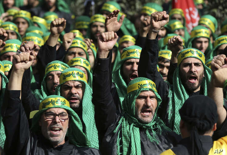Lebanese Shi'ite supporters of the Iranian-backed Hezbollah group, shout slogans as they march marking the Ashoura holiday, in a southern suburb of Beirut, Lebanon, Oct. 12, 2016.