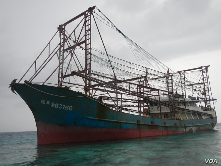 A suspected Chinese fishing vessel that got stuck on a protected reef in the Philippines, April 8, 2013. (Philippines Navy)