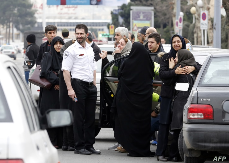 Relatives of Iranian passengers, onboard the Aseman Airlines flight EP3704, react as they gather in front of a mosque near Tehran's Mehrabad airport, Feb. 18, 2018.