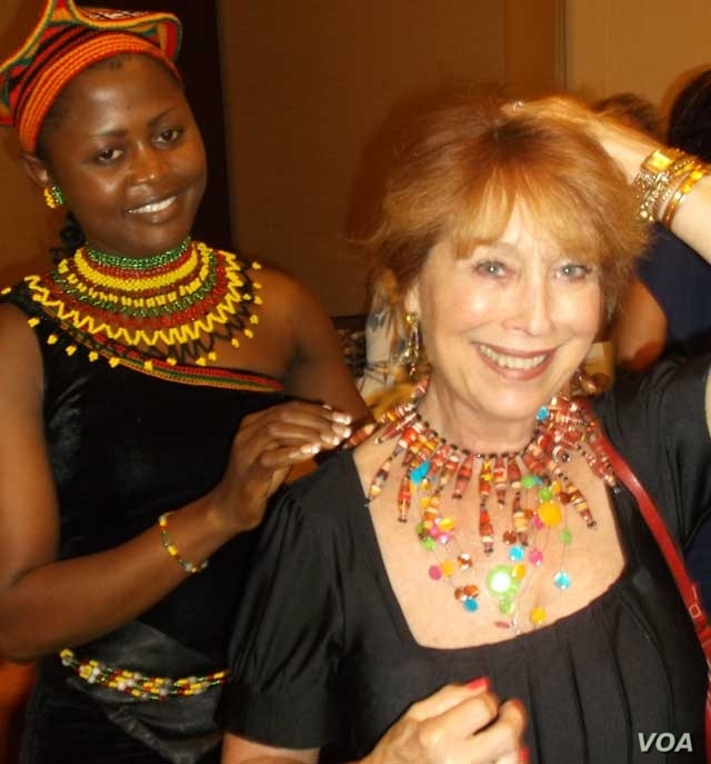 Jacqueline Kamsu tries one of her handmade necklaces on an American customer. (Kamsu)