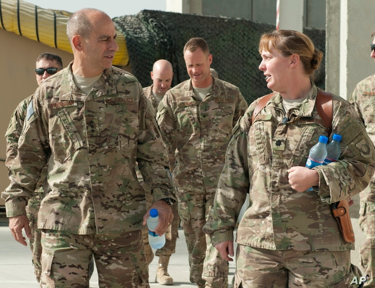 In this image provided by the U.S. Air Force, Lt. Gen. Jeffrey Harrigian, who is currently head of U.S. Air Force's operations throughout the region, walks with Lt. Col. Joy Boston, 455th Expeditionary Operations Support Squadron commander at Bagram ...