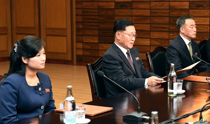 In this photo provided by South Korea Unification Ministry, the head of North Korean delegation Kwon Hyok Bong, center, and Hyon Song Wol, head of the Moranbong Band, left, sit during a meeting with South Korean officials at the North side of Panmunj...