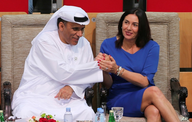 FILE - In this Oct. 27, 2018 photo, Israeli Culture and Sport Minister Miri Regev shakes hands with Mohamed Bin Tha'loob Al Derai, President of UAE Wrestling Judo & Kickboxing Federation, after an Israeli athlete won the bronze medal during a tournam...