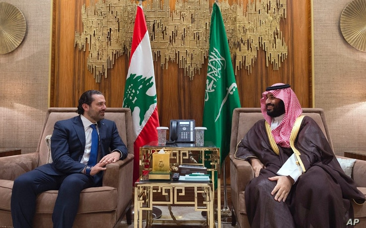 FILE - In this Oct. 30, 2017 photo,  Saudi Crown Prince Mohammed bin Salman, right, meets with Lebanese Prime Minister Saad Hariri in Riyadh, Saudi Arabia.