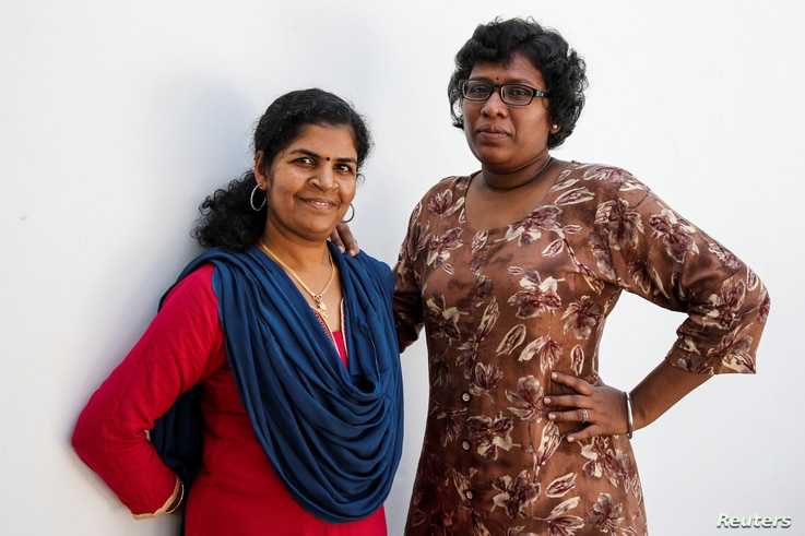 Kanaka Durga, 39 (L) and Bindu Ammini, 40, the first women to enter Sabarimala temple which traditionally bans the entry of women of menstrual age, pose for a photo on the outskirts of Kochi, India, January 10, 2019.