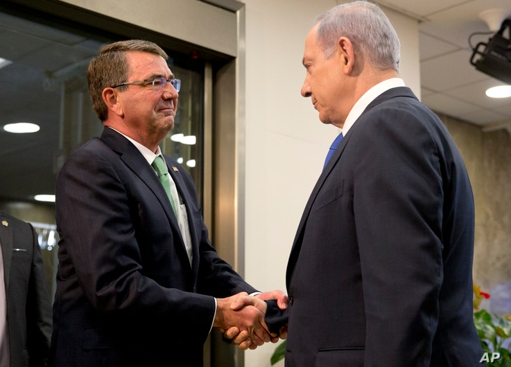U.S. Defense Secretary Ash Carter, left, is greeted by Israeli Prime Minister Benjamin Netanyahu as he arrives at the prime minister's office in Jerusalem, Israel, Tuesday, July 21, 2015. Carter said he has no expectation of persuading Israeli leader...