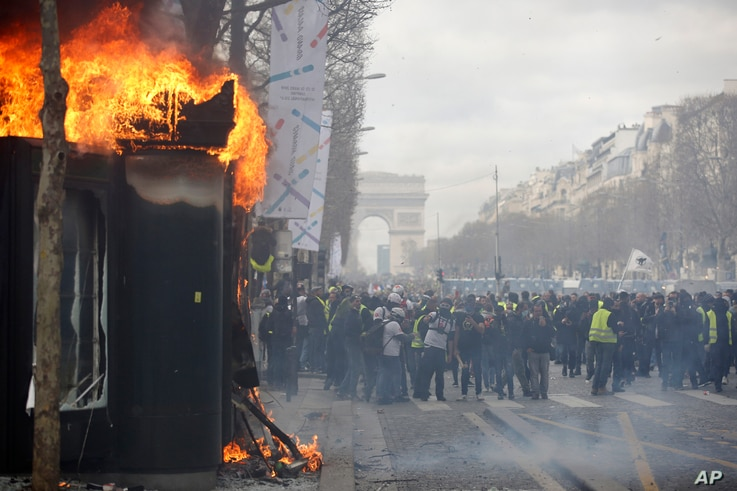A newsstand burns during a yellow vests demonstration on the Champs Elysees avenue in Paris, France, March 16, 2019.