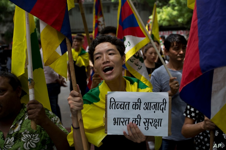 Exile Tibetans shout slogans during a protest to show support with India on Doklam standoff in New Delhi, India, Aug. 11, 2017.