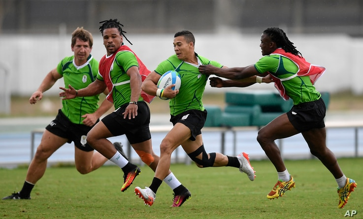 South Africa's Cheslin Kolbe runs with the ball during a men's rugby sevens team training session ahead of the 2016 Summer Olympics in Rio de Janeiro, Brazil, Aug. 3, 2016.