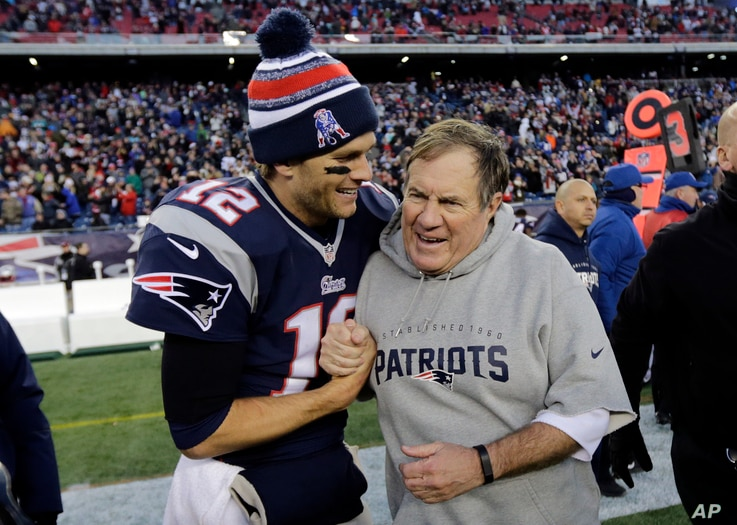 New England Patriots quarterback Tom Brady, left, celebrates with head coach Bill Belichick after winning a football game, Dec. 14, 2014, in Foxborough, Mass.
