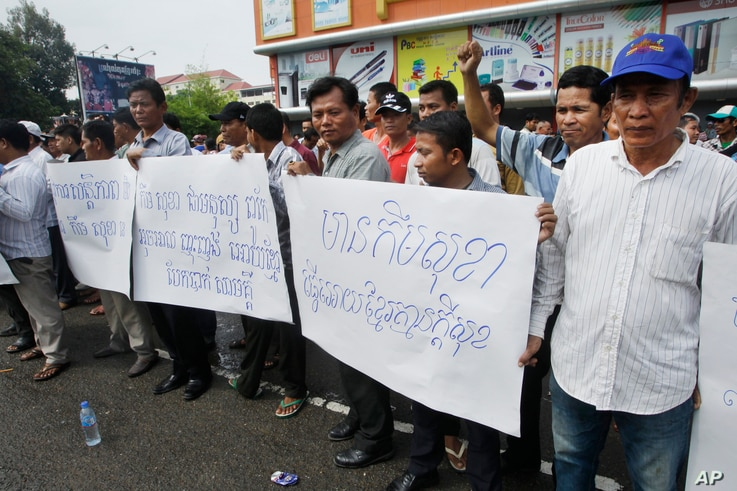 Pro-ruling party demonstrators stage a protest rally in front of National Assembly in Phnom Penh, Cambodia, Monday, Oct. 26, 2015.