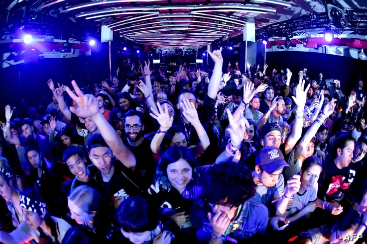 Festival goers watch the Stokes at Samsung Galaxy Life Fest at SXSW 2016 on March 11, 2016 in Austin, Texas.