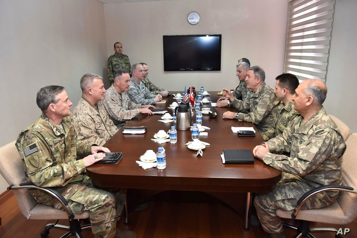 The U.S. chairman of the Joint Chiefs of Staff, Gen. Joseph Dunford, third left, and Turkey's Chief of Staff Gen. Hulusi Akar, third right, talk during a meeting in Incirlik Airbase in Turkey, Feb. 17, 2017.