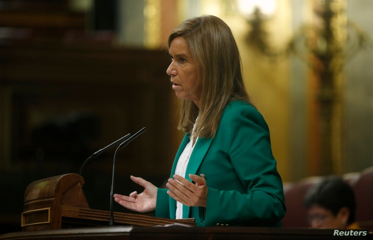 Spanish Health Minister Ana Mato answers a question in parliament about the Ebola crisis, in Madrid, Oct. 15, 2014.