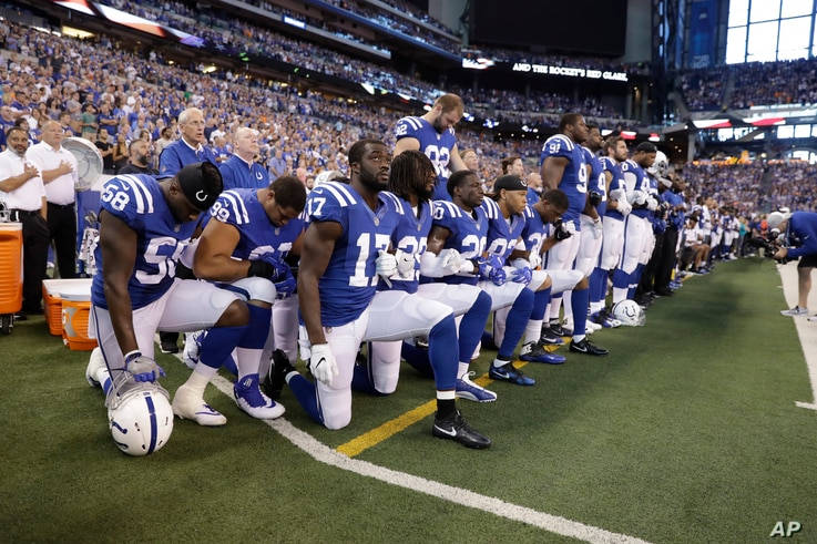 Members of the Indianapolis Colts kneel during the nation anthem before an NFL football game against the Cleveland Browns in Indianapolis, Indiana, Sept. 24, 2017.