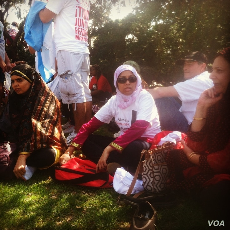 "Bangladeshi-born Farzana Morshed of the Queens Community House sits in the shade on the edge of the ""All in for Citizenship"" rally at the U.S. Capitol in Washington, DC, Wednesday, April 10, 2013. (Photo by Kate Woodsome)"
