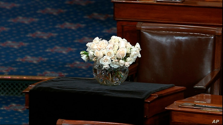 The desk of Sen. John McCain, R-Ariz., is draped in black on the floor of the U.S. Senate, Aug. 27, 2018, on Capitol Hill in Washington.