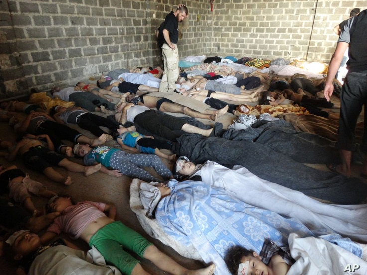 A photo taken on August 22 purports to show some of the estimated 1,000 victims of a suspected chemical weapons attack in the Damascus suburb of East Ghouta, the day after a missile attacked by government forces. The government denies chemical weapon...