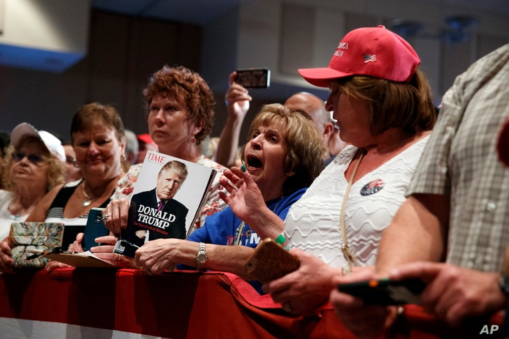 Supporters cheer for Republican presidential candidate Donald Trump during a campaign rally, Aug. 12, 2016, in Altoona, Pa.