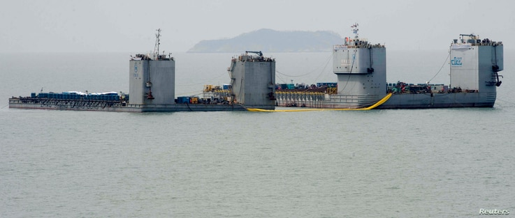 Barges are seen during a salvage operation of sunken ferry Sewol at the sea off Jindo, South Korea, March 22, 2017.