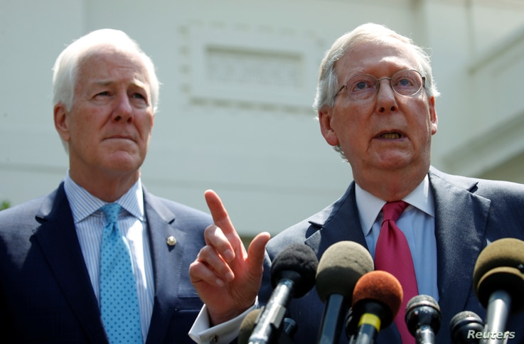 Senate Majority Leader Mitch McConnnell, right, and Senate Majority Whip John Cornyn speak to reporters after U.S. President Donald Trump's meeting with Senate Republicans to discuss health care at the White House in Washington, July 19, 2017.