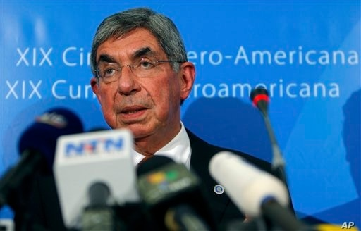 Costa Rica's President Oscar Arias Sanchez addresses journalists on the topic of Sunday's elections in Honduras during the XIX Ibero American summit in Estoril, outside Lisbon, Monday, Nov. 30, 2009. Sunday's ballot in Honduras came five months after...