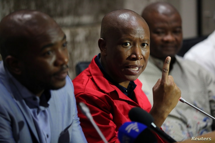 FILE - Julius Malema, leader of the opposition Economic Freedom Fighters (EFF) party, speaks during a media briefing at Parliament in Cape Town, South Africa, Feb. 12, 2018.