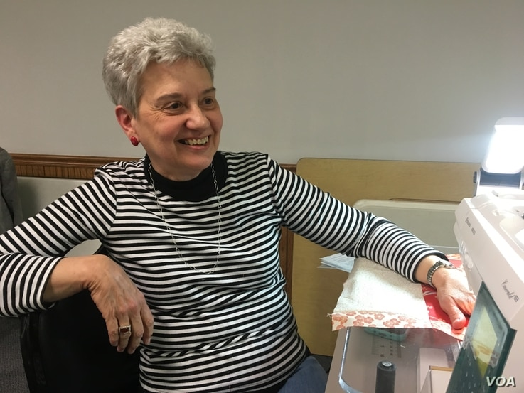 Linda Ebersole, of Rock Falls, Ill., takes a break from her weeking sewing gathering at the Fulton Community Center in Fulton, Ill.