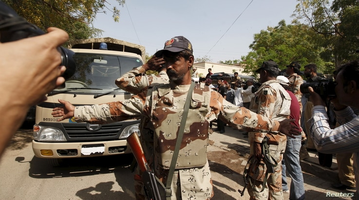 A Pakistan Ranger gestures to stop members of the media from taking pictures at an anti-terrorism court in Karachi, Pakistan, March 12, 2015. Since the military courts were reinstated in 2015, verdicts have been issued in more than 300 terrorism-rela...