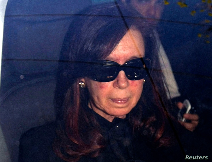 FILE - Argentina's President Cristina Fernandez is seen sitting in a car as she arrives at a hospital in Buenos Aires October 7, 2013.
