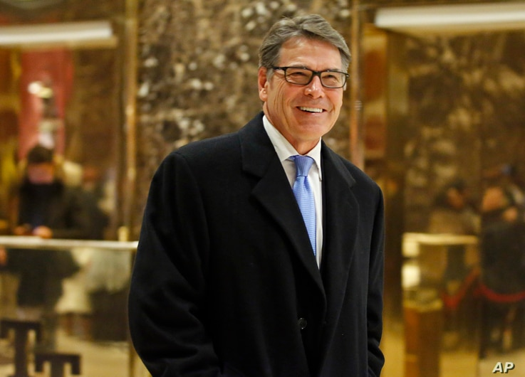 Former Texas Gov. Rick Perry smiles as he leaves Trump Tower, Dec. 12, 2016, in New York.