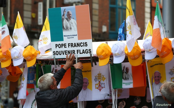 A man sells Pope Francis souvenirs at a stall in Dublin, Ireland Aug. 24, 2018.
