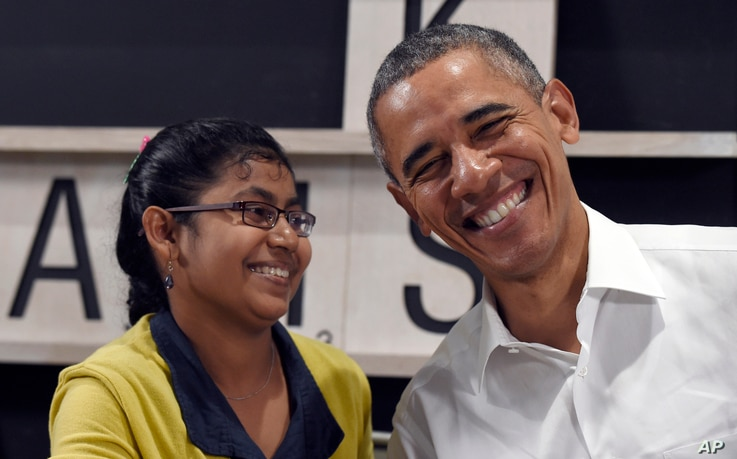 President Barack Obama shares a laugh with a 16-year-old refugee from Myanmar after speaking about the refugee situation during a visit to the Dignity for Children Foundation in Kuala Lumpur, Malaysia, Nov. 21, 2015.