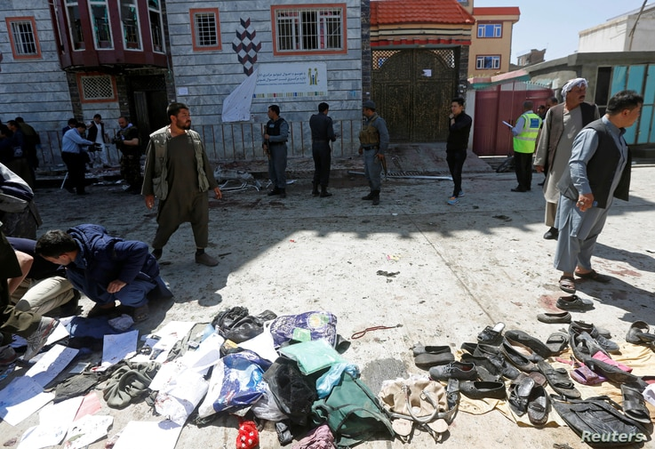 Clothes and sandals are seen at the site of a suicide bomb attack in Kabul, Afghanistan, April 22, 2018.