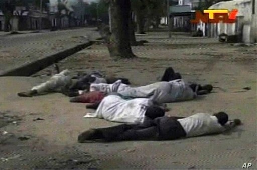 Frame grab from TV footage shot by Nigeria television authority shows people lying down (condition unknown) on a street in Maiduguri, Oct. 8, 2012. Nigerian officials purportedly dumped dozens of corpses in front of a hospital in northeast Nigeria af...