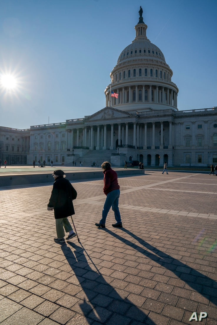 FILE - People visit the Capitol during the recent federal government shutdown over border wall money, in Washington, Dec. 26, 2018.