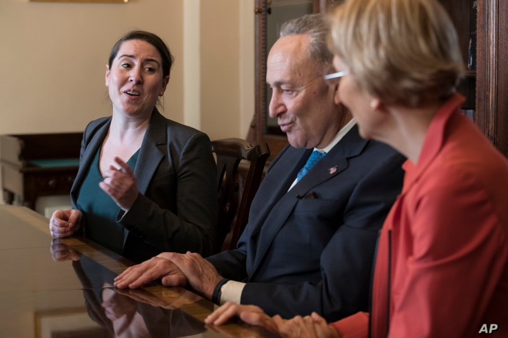 From left, Leandra English, who was elevated to interim director of the Consumer Financial Protection Bureau, meets with Senate Minority Leader Chuck Schumer, D-N.Y., and Sen. Elizabeth Warren, D-Mass., in Washington, Nov. 27, 2017.