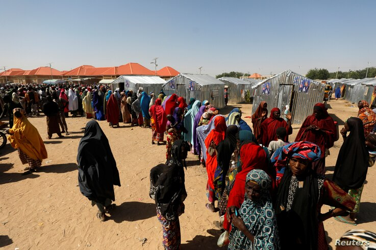 Women line up for relief at the Teachers' Village IDP camp in Maiduguri, Nigeria Jan. 16, 2019.