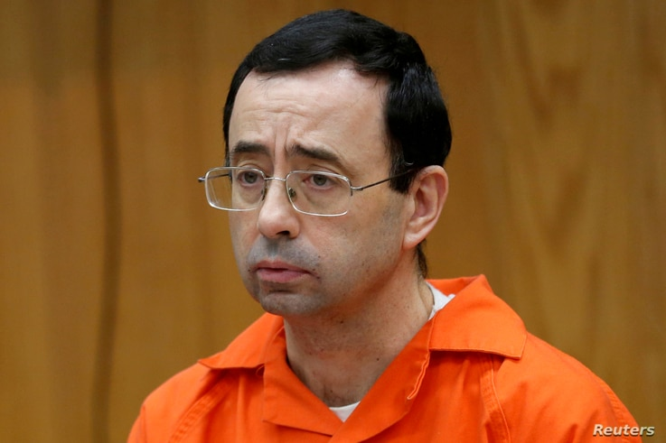 FILE PHOTO: Larry Nassar, a former team USA Gymnastics doctor who pleaded guilty in November 2017 to sexual assault, listens to victims impact statements during his sentencing in the Eaton County Circuit Court in Charlotte, Michigan,  Jan. 31, 2018. ...