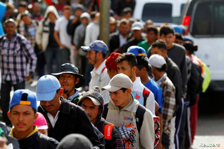 Migrants, part of a caravan of thousands trying to reach the U.S., stand in line for a free meal after arriving in Tijuana, Mexico, Nov. 13, 2018.