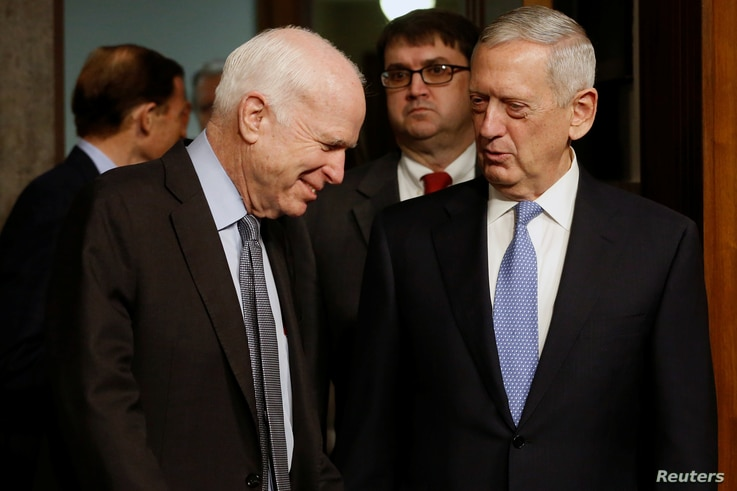 Committee chairman U.S. Senator John McCain, left, welcomes retired U.S. Marine Corps General James Mattis to testify before a Senate Armed Services Committee hearing on his nomination to serve as defense secretary in Washington, Jan. 12, 2017.