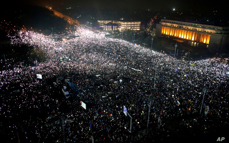 Tens of thousands of people gather for a demonstration in from of the government building in Bucharest, Romania, Sunday, Feb. 5, 2017.